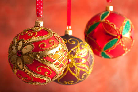 goodies: Christmas baubles on red background