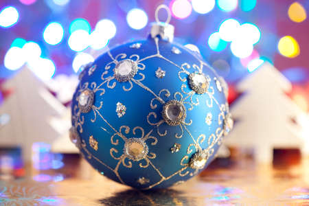 christmas baubles: Blue Christmas bauble and white trees on colored background