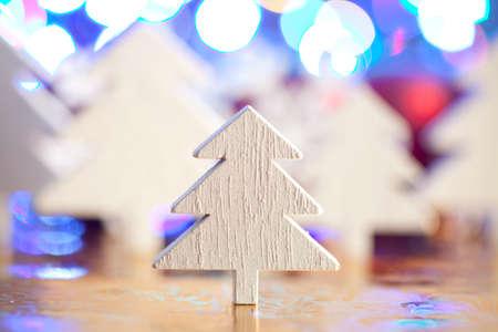 goody: Wooden Christmas tree on lighting background Stock Photo