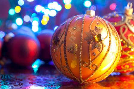 lighting background: Christmas baubles on lighting background