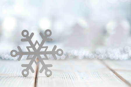 goody: Snowflake on wooden and silver background Stock Photo