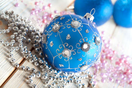 goody: Blue Christmas bauble on wooden background Stock Photo