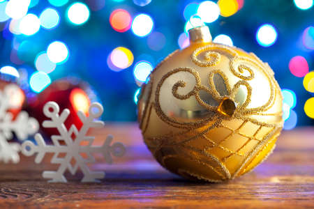 lighting background: Christmas bauble and snowflakes on lighting background