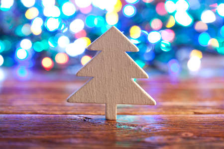 lighting background: Wooden Christmas tree on lighting background Stock Photo