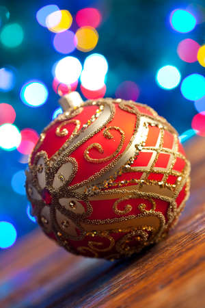 lighting background: Red Christmas bauble on lighting background