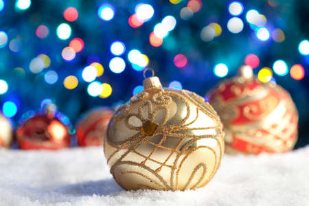 christmas baubles: Christmas baubles on snow and lighting background
