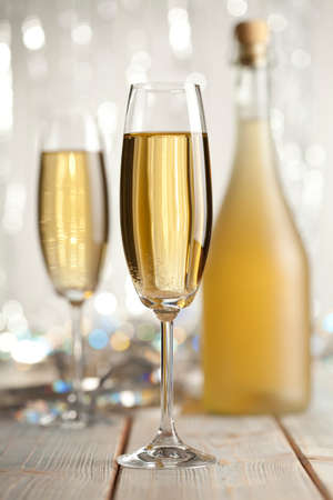 gold flute: Happy new year - glasses of champagne and bottle on shining background Stock Photo