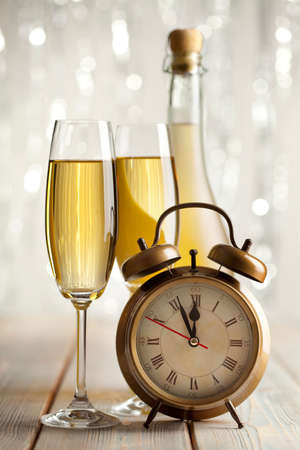 silver flute: Happy new year - glasses of champagne and alarm clock