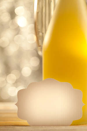 silver flute: Blank paper ticket, bottle of champagne and bokeh background