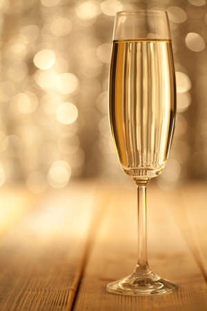 silver flute: Glass of champage on bokeh background