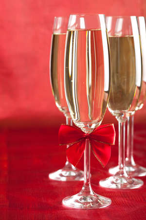 gold flute: Glasses of champagne on red background Stock Photo