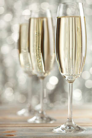 gold flute: Glasses of champagne on silver background Stock Photo
