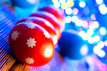 lighting background: Red Easter eggs on lighting background Stock Photo