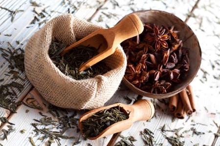Dried tea leaves in jute bag and anise Stock Photo
