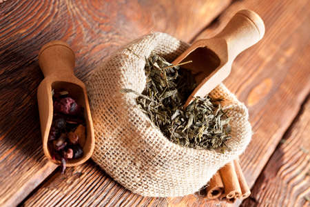 blend: Tea leaves in linen bag on wooden table