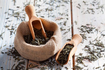 Dried tea leaves on wooden table