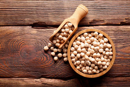indian spice: Chickpeas in bowl on wooden table Stock Photo
