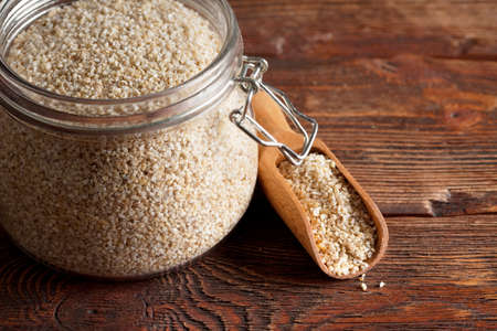 wooden scoop: Buckwheat in a jar and wooden scoop