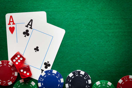 Playing cards, poker chips, and dices on green table Reklamní fotografie