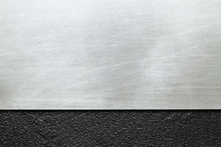 Two layer background - metal surface and plastered wall Stock Photo