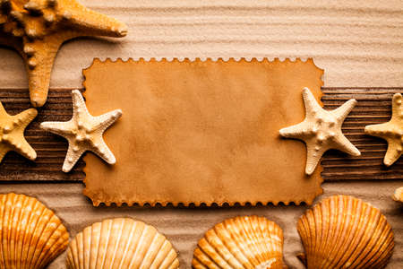 sheet of paper: Blank paper sheet, shells and starfish on beach sand Stock Photo
