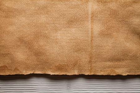 Handmade paper sheet on wooden planks