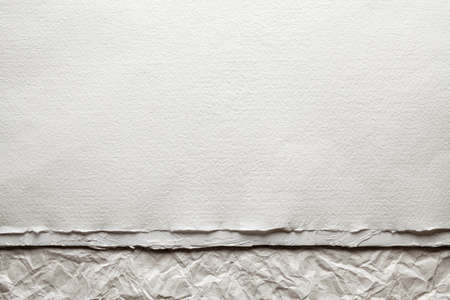 White paper sheet on crumpled paper background Stock Photo