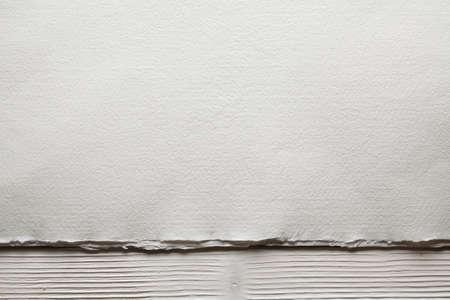 White paper sheet on wooden planks