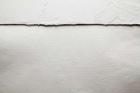 White plaster on the wall and handmade paper sheet background or texture
