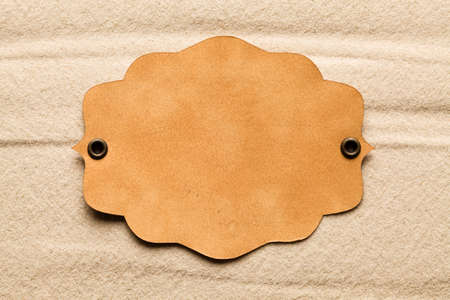 sheet of paper: Blank paper label on beach sand