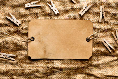 Blank paper card on fabric background Stock Photo