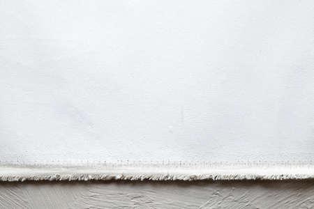 Blank paper sheet on white plastered background