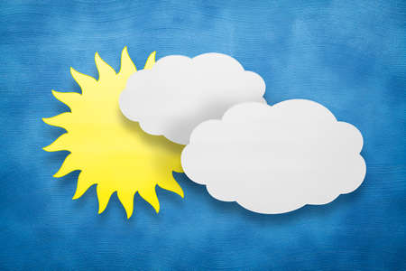Abstract background - two clouds and sun on blue background Stock Photo