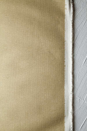 Canvas material on plastered wall background