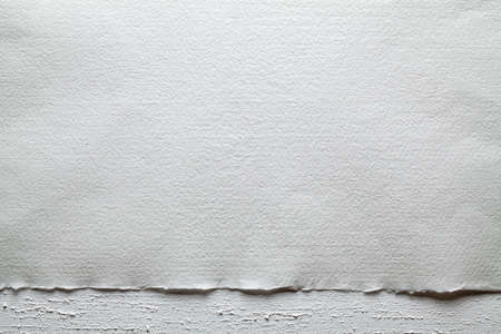 Two layer background - paper sheet on white plastered wall