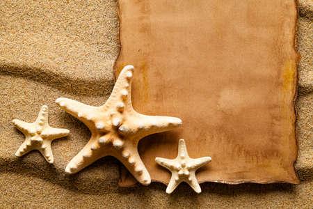 ebd3750b7be Handmade paper sheet and starfish on sand Stock Photo