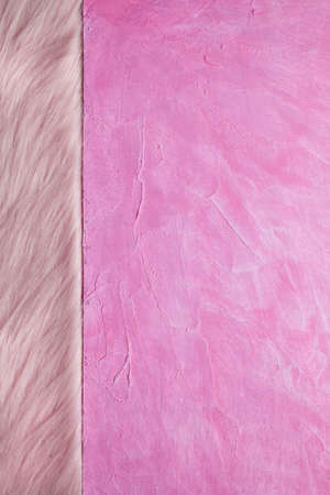 Double-layered background - pink plaster surface and pink fur Stock Photo