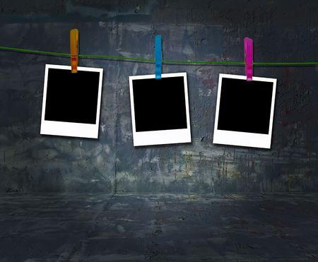 Blank Photos Hanging on a Clothes Line in Dark Grungy Room Stock Photo - 6279978