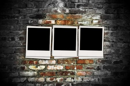 recollections: Blank Photos on Grungy Brick Wall Stock Photo