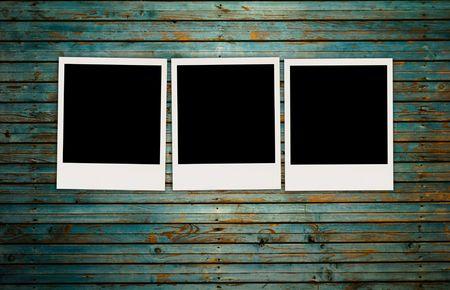 Three Blank Photos on Shabby Wall photo
