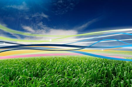 sway: Ribbons in the Wind in Beautiful Green Field Stock Photo