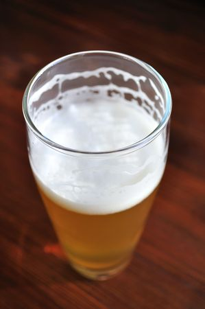 unfiltered: Unfinished Glass of Unfiltered Beer  Stock Photo