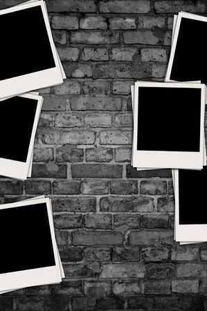 Blank Photos on Dark Brick Background photo