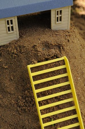 Toy House with Ladder on Sand Stock Photo - 7520711