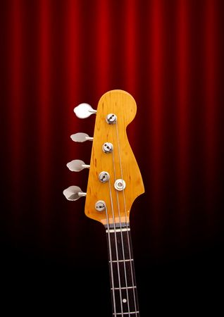 Bass Guitar Head on Dark Red Background photo