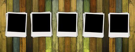 polaroids: Five Blank Polaroids on Wooden Wall Stock Photo