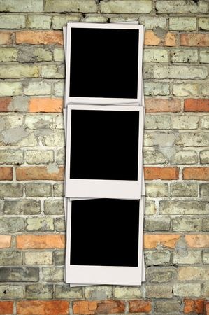 vertical: Lege Photos on brick wall  Stockfoto