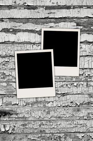 white polaroids: Blank Photos on Shabby Wall