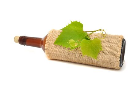 Bottle of Wine in Sackcloth with Grapevine photo