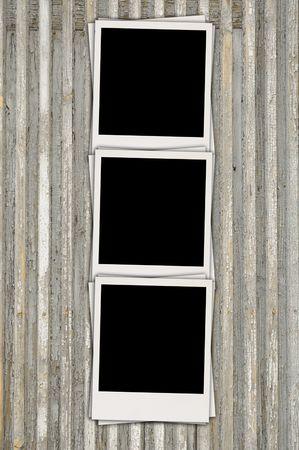 Three Blank Photos on Wood Background photo